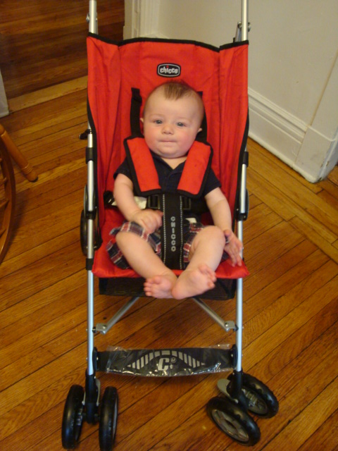 Emmett in his red Chicco umbrella stroller