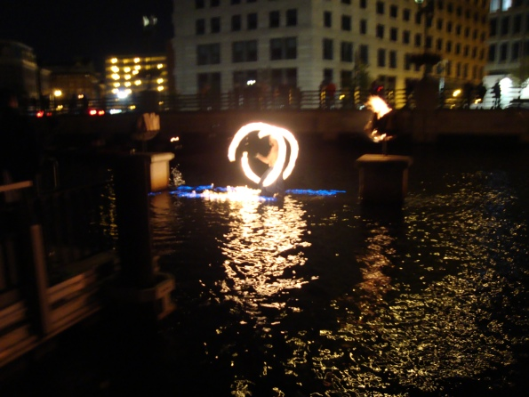 WaterFire man playing with fire