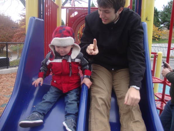 toddler, dad on slide